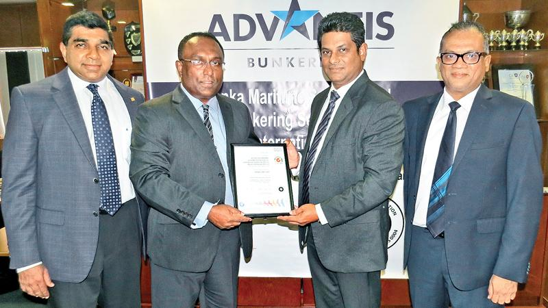 Business Manager, SGS Lanka, Chamika Wimalasiri (third from left) presents the OHSAS certificate to Director, Advantis Bunkering, Praneeth Gunawardena (second from left). Managing Director, Hayleys Advantis Ruwan Waidyaratne (extreme left) and Group Director, Hayleys Advantis, Shano Sabar (extreme right) look on.