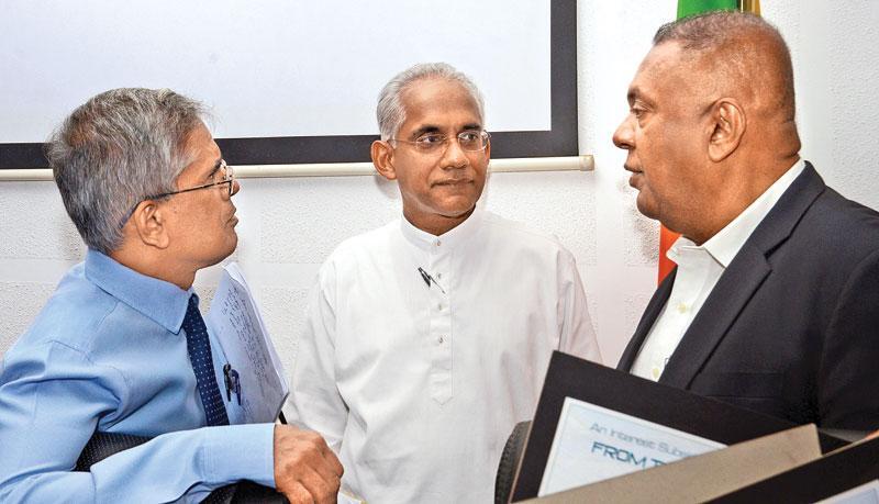 Finance and Media Minister Mangala Samaraweera, State Minister of Finance, Eran Wickremaratne and Finance Ministry Secretary, Dr. D.H.S. Samaratunga before announcing the Divi Udana scheme at the Ministry. (Pic: Wimal Karunatilaka)