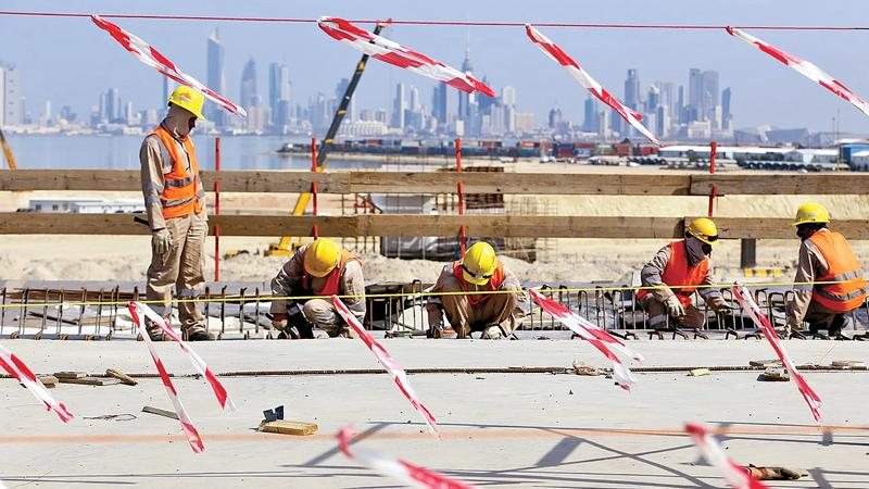 Road to ruin? … labourers at work on the Sheikh Jaber Al-Ahmad Al-Sabah causeway in Kuwait City in February. Pic: Yasser Al-Zayyat/AFP/Getty