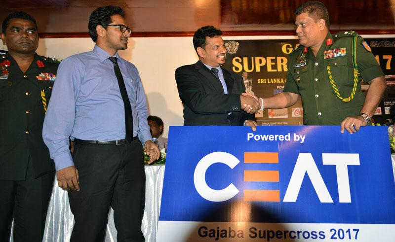 Major General Shavendra Silva the chairman of the Gajaba Supercross 2017 Organizing Committee receives the main sponsor ship from Bishri Latif of CEAT Kelani Tyre Lt. Also in the picture are for left Col.Mahinda Rajapaksa and Tharindu Mihiraka. Picture by Rukmal Gamage.