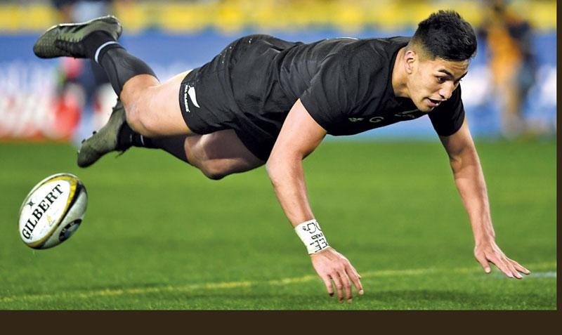 New Zealand's wing Rieko Ioane scores a try during the Rugby Championship test match between Australia and the New Zealand All Blacks in Sydney on August 19, 2017. -AFP