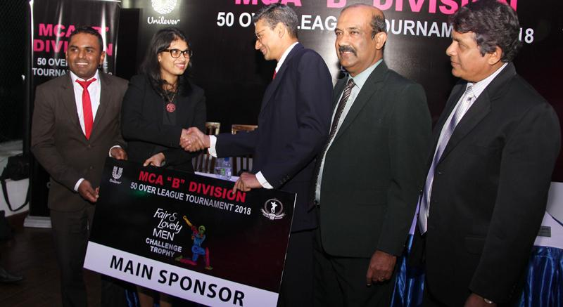 """Marketing Manager Unilever """"Skin Care and Hair Care' Nilushi Jayathilaka  hands over the sponsorship to president of Mercantile Cricket Association  Niran Mahawatte. Also in the picture are (from Left) Senior Brand Manager Unilever Sri Lanka Daminda Perera,Secretary MCA Nalin Wickramasinghe and  Tournament Committee Chairman Sujeeva de Silva. Picture by Rukmal Gamage."""