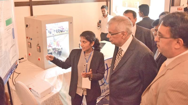 Prime Minister Ranil Wickremesinghe inspects some of the engineering research projects presented by undergraduate and postgraduate research students of the Peradeniya University at the Waters Edge, Battaramulla last week. Vice Chancellor of the Peradeniya University Prof. Upul Dissanayake and other senior academics are also present. Picture by Sudath Nishantha