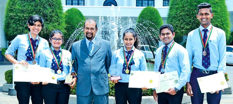 The winning IHS students with Principal Ravindra Magedera