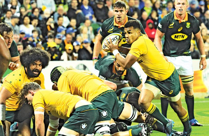 Australia's Will Genia runs with the ball during the Rugby Championship match between Australia and South Africa in Perth on September 9, 2017