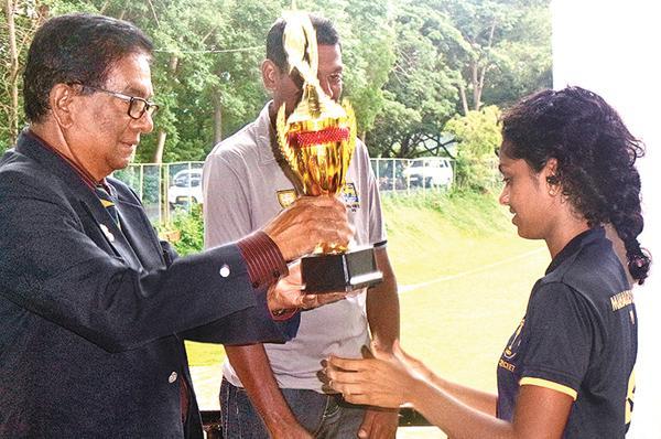 Manager of the Palinks Cricket team, Palitha Gunasekera awarding the Runners-up trophy to Udara Bandara Captain of Mahamaya Girls College.