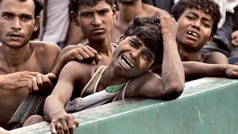 Rohingya Muslim refugees fleeing Burmese military operations swell to nearly half a million.