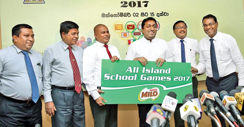Minister of Education Akila Viraj Kariyawasam receives the sponsorship for the All Island School Games from Vice President Nestle Lanka Ltd. Bandula Egodage (extreme right). Also in the picture are from left S. Weerasinghe, Sunil Jayaweera (Special Advisor Physical Training & Sports), Sunil Hettiarachchi (Ministry Secretary) and A. Senani Hewage (Asst. Secretary) picture by Rukmal Gamge