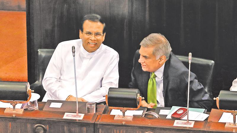 President Maithripala Sirisena and Prime Minister Ranil Wickremesinghe share a light moment during a special session to commemorate the 70th anniversary of Parliament last week. Pic: Thilak Perera