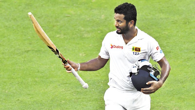 Dimuth Karunaratne of Sri Lanka leave the field after being dismissed by Wahab Riaz of Pakistan during the second day of the second Test cricket match between Sri Lanka and Pakistan at Dubai International Stadium in Dubai on October 7, 2017.  - AFP PHOTO