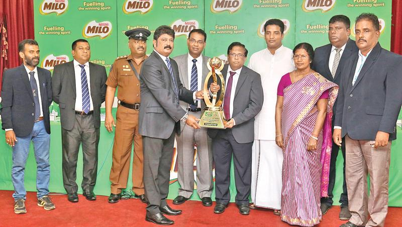 Nestle Lanka Sales Manager (North) S. Raveendran hands over the Cup to N.Vethanayakan G.A Jaffna at the Media briefing. Also in the picture are from left B.Mukunthan Football Coach (Jaffna), Senior Manager -Activation Nestle Lanka PLC Sanjeewa Wickramasinghe, Gamini Hewawitharana H.Q.I Jaffna, Police, Bandula Egodage Vice President- Corporate Affairs Nestle Lanka PLC, E.Arnold Sports Coordination Northern Province, P. SelvinAdditioal Provincial Director of Education Northern Province, K.Vijitharan DSO Jaffn