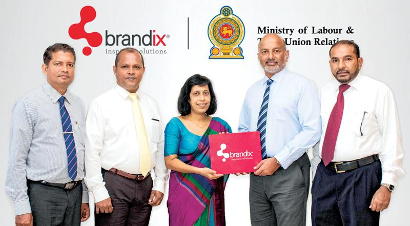 Brandix Apparel Director, Air Chief Marshal (Retd) Harsha Abeywickrema (second right) presents the sponsorship cheque to Director General NIOSH, Dr (Ms) Champika Amarasinghe. Looking on are (from left): Assistant Director – Finance, NIOSH, Mohan Perera; Manager – Group Occupational Safety, Brandix, RohanWijesooriya;  and Cluster Manager – Health & Safety, Brandix Fast Fashion and Athleisure, Susith Rajaguru