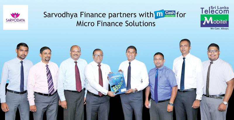 From left: Buddhika Goonawardene -Senior  Manager-IT, Rasika Epasinghe - AGM - Marketing, Business Development  & Deposit Mobilization, Kenneth Mendis - AGM - Alternate Channels  and Dharmasiri Wickramatilake - Chief Executive Officer of Sarvodaya  Development Finance, Isuru Dissanayaka, Senior General Manager  Marketing, Kalhara Gamage - Head of Mobile Financial Services, Padmanath  Muthukumarana - Manager - Mobile Financial Services and Gayan  Kalugamage - Product Executive - Mobile Financial Services of