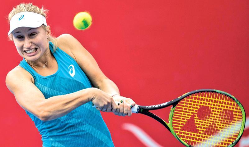 Australia's Daria Gavrilova hits a return against Jennifer Brady of the US during their women's singles semi-final match at the Hong Kong Open tennis tournament on October 14, 2017.  / AFP PHOTO / DALE DE LA REY