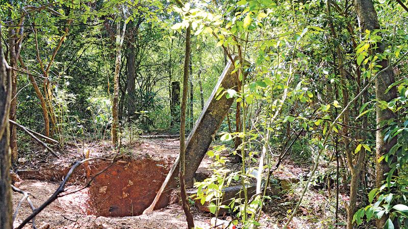 Vandalism: the hole dug to remove  a stone pillar by treasure hunters