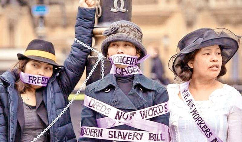 Domestic workers dressed as suffragettes demand the right to be able to change employers once in the UK at a protest in London in 2015. The change was made but campaigners claim it has not been properly implemented.  Pic: Dominic Lipinski/PA
