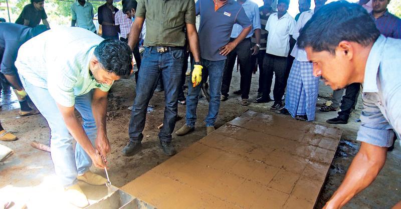 Prof. Rangika Halwathura removing the moulded bricks