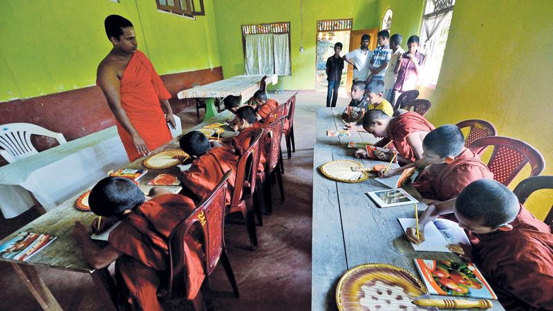 At an elevation of over a thousand metres at the Batatota cave temple in the outskirts of Eratna, a group of student Samanera Bhikkus learn English at a newly set up English medium Pirivena.