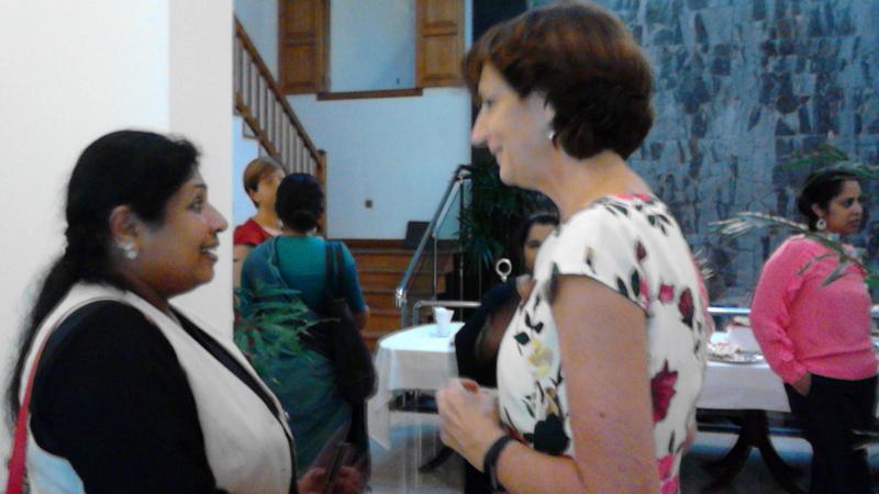 Dutch Ambassador in Colombo Joanne Doornewaard  talks to a woman candidate