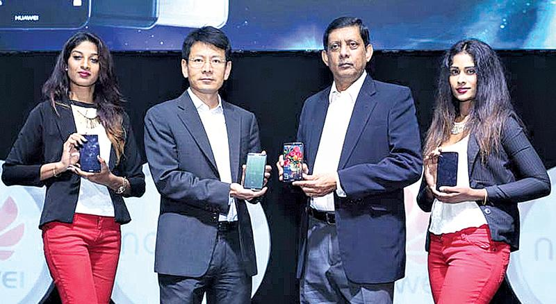 Huawei Sri Lanka CEO Shunli Wang and Singer Sri Lanka PLC Marketing Director Kumar Samarasinghe introduce the Huawei nova 2i.