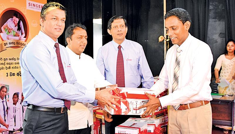 "Chief Guest at the event, Education Minister Akila Viraj Kariyawasam, Singer Sri Lanka PLC Director Sales and Commercial Mahesh Wijewardene, and Marketing Director Kumar Samarasinghe at the ""Singer Soopa Shasthra"" program"