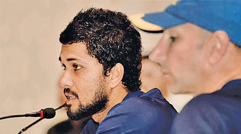 Sri Lankan skipper Dinesh Chandimal (L) with coach Nic Pothas addressing the media in Kolkata on Thursday.   PTI