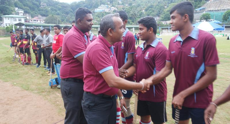 Rasitha Abeykoon, President of the Old Rajan's Hockey Association being   Introduced to the Asoka Vidyalaya, Colombo and Dharmaraja College Hockey teams  in their inaugural match by Dinuka Samarasinghe, the Secretary of the Old Rajans Hockey Association.