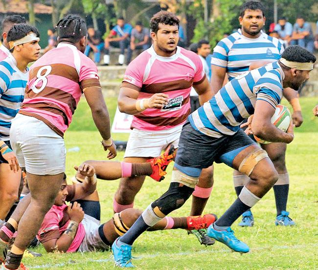 Navy's Lahiru Herath breaks off from the Havelocks defense in the Dialog 'A' division rugby encounter at Welisara yesterday. Navy beat Havies 25-14 .Pic: Sudam Gunasinghe