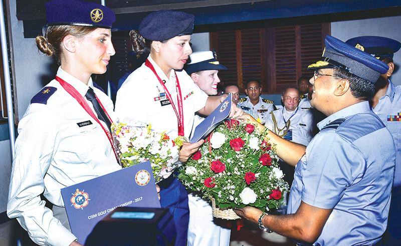 USA women Services team receives their Championship Award from Commander of Sri Lanka Air Force, Air Marshal Kapila Jayampathy