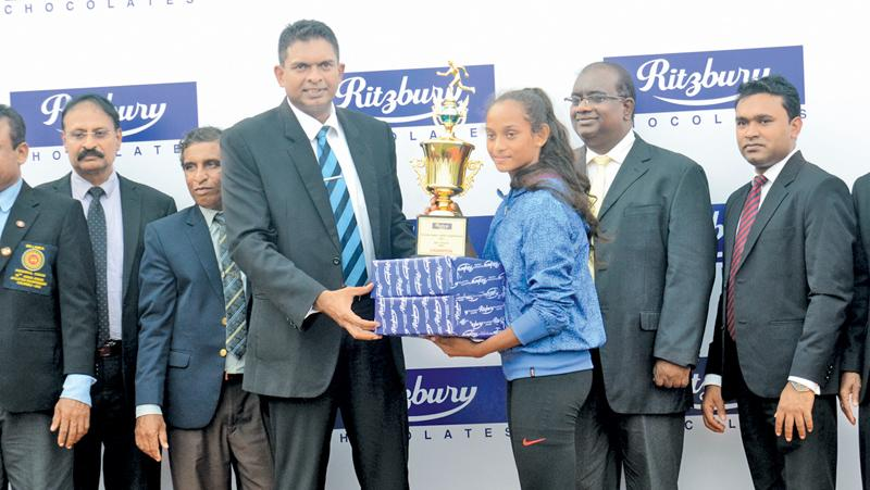 Best Female Athlete S. H.Sadini Kavisha (Vijitha Madya Maha Vidyalaya, Dickwella) receiving her award