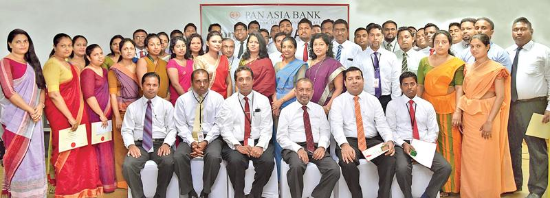 Recipients of Long Service Awards with CEO and Head of Human Resources of Pan Asia Bank.