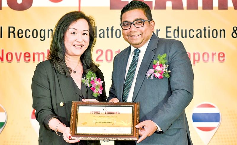 AIS Principal Harshana Perera receives the Distinguished Educationist Award from President, Technological and Higher Education Institute, Hong Kong, Prof. Christina Hong.