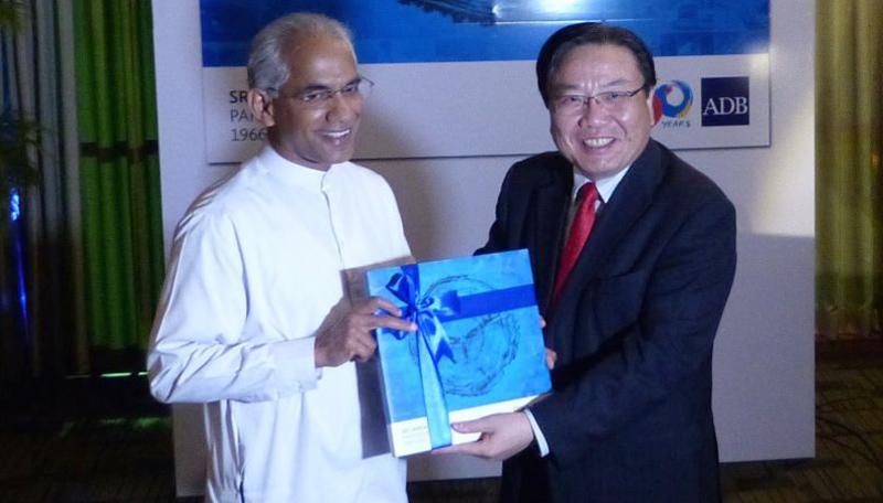 State Minister of Finance and Mass Media, Eran Wickramaratne (left), and ADB VP Wencai Zhang launched 'Sri Lanka-ADB Partnership: 1966–2016' in Colombo last week.