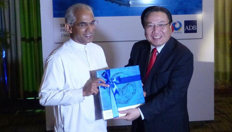 State Minister of Finance and Mass Media, Eran Wickramaratne (left), and ADB VP Wencai Zhang launched 'Sri Lanka-ADB Partnership: 1966–2016' in Colombo last week.