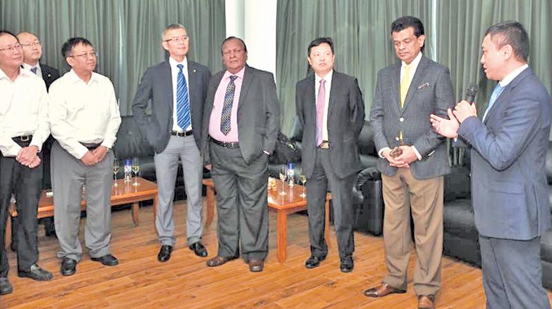 Guests and senior officials of CICT at the commissioning of the  E-RTGs. (From right): Ray Ren, CEO of CICT, Dr Parakrama Dissanayake,  Chairman SLPA, Chen Jiaqing, Managing Director ZPMC International Group,  P. G. Dassanayake, Vice Chairman SLPA, Hang Tian, Chairman of CICT, Ma  Yong, General Manager CMPort, Raymond Mu, CFO of CICT and Zhang Yihe,  General Manager Haiqin.