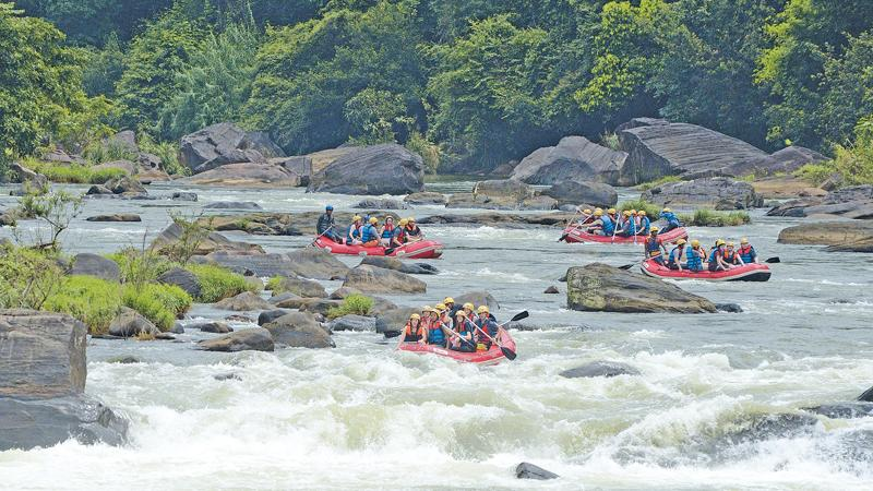 DIFFICULT TASK: The gushing water of Maskeliya Oya with rubber rafts rushing down the river evading rocks.