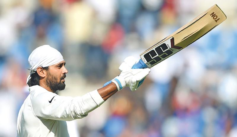 Indian opener Murali Vijay celebrates his hundred on the second day of the second Test against Sri Lanka at the Vidarbha CA stadium in Nagpur on Saturday. AFP