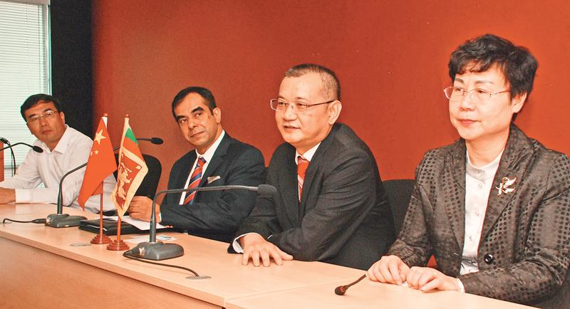 At the head table (from right) Vice Chairperson Liuzhou Committee of the Chinese People's Political Consultative Conference, Madam Liu Xiangqun, Vice Chief Executive, The People's Government of  Shijingshan district, Beijing, Xiao Ping, Director, Media and Publicity, BOI, Dilip S. Samarasinghe, and Deputy Secretary, Guigang Committee of the Communist Party of China, Li Wanchun.