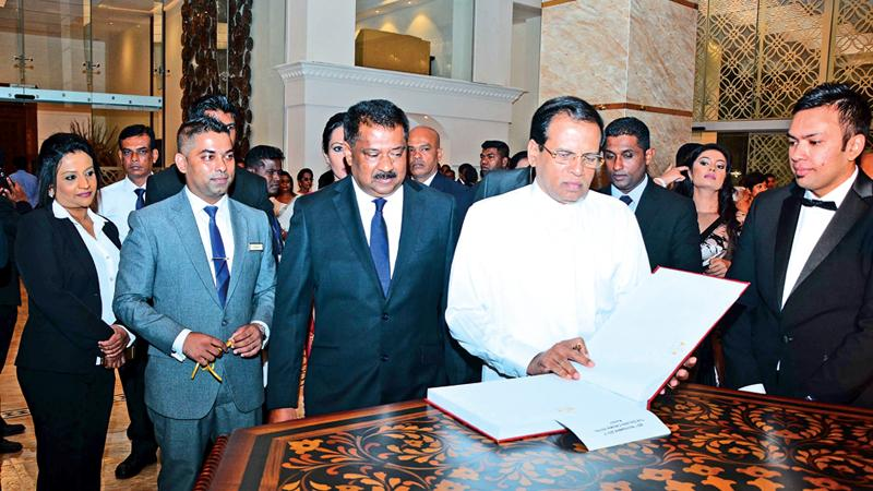 President Maithripala Sirisena together with the Chairman of Golden Crown Hotel Shryananda Wijekoon, Managing Director Chanuka Wijekoon, Director Finance Hansani Wijekoon inaugurate the newly opened super luxury hotel Golden Crown in Ampitiya, Kandy.  Pix: Sudath Malaweera