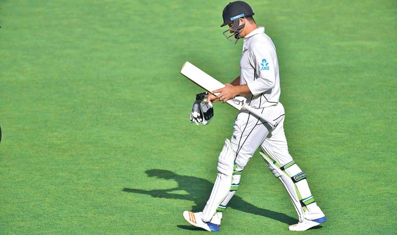 New Zealand's Colin de Grandholme walks from the field after being caught during day two of the first Test cricket match between New Zealand and the West Indies at the Basin Reserve in Wellington