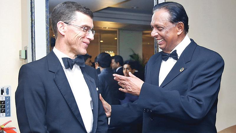 British High Commissioner in Sri Lanka James Dauris shares a light moment with Minister Amaratunga