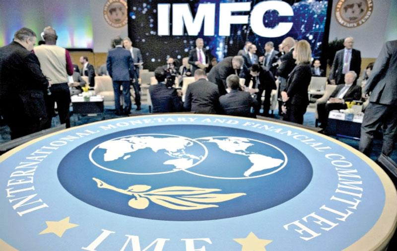Attendees wait to begin an International Monetary Fund Committee (IMFC) plenary session at the International Monetary Fund (IMF) and World Bank Group Annual Meetings in Washington, D.C., U.S., on Saturday, Oct. 14, 2017. Near-term risks to world financial stability have declined since April amid improving macroeconomic conditions and the subsiding risk of emerging-market turmoil, the IMF said in its latest Global Financial Stability Report released yesterday. Photographer: Andrew Harrer/Bloomberg