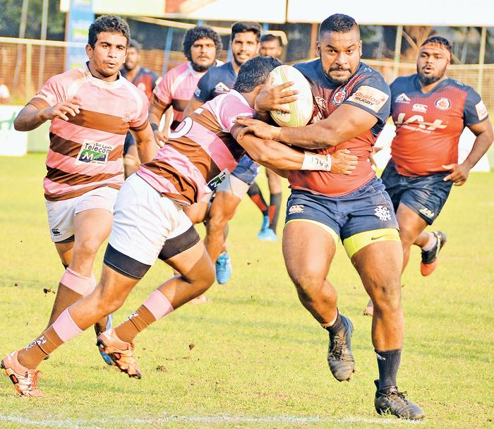 Action in the keenly fought out Dialog 'A' division rugby match between Havelocks SC and CR&FC at Longden Place yesterday.  Pic by Saman Mendis