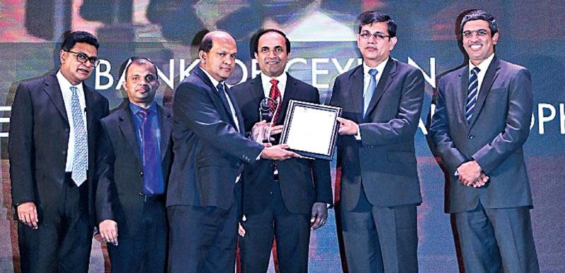 The Bank of Ceylon's Non-Executive Director and Audit Committee Chairman Ranel T. Wijesinha (left) and the Deputy General Manager Treasury,  Investment and International/ Chief Financial Officer Russel Fonseka  (middle) receive the award from Vice President of CA Sri Lanka,    Jagath Perera.