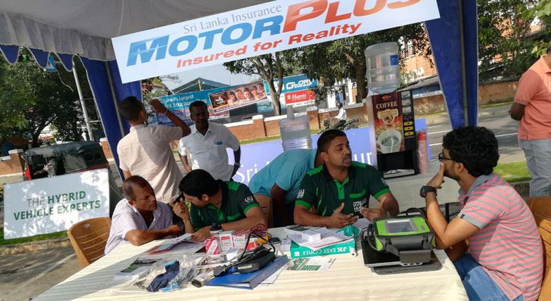 Hybrid vehicle owners in discussion with Edirisinghe Brothers' Hybrid Hub team members.