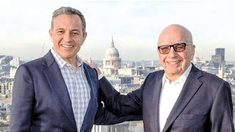 Disney's long-standing chief executive Bob Iger (l) struck the deal with Rupert Murdoch