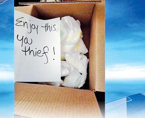 A box filled with dirty diapers and a note for a package thief