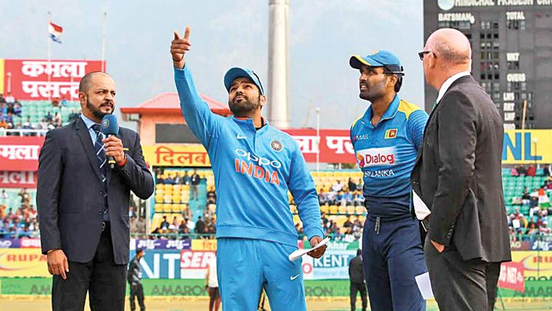 Rival captains Rohit Sharma and Thisara Perera.