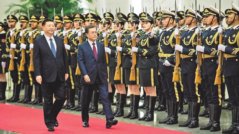 President Xi Jinping of China,  and President Moon Jae-in of South Korea at a welcoming ceremony in Beijing on Thursday.