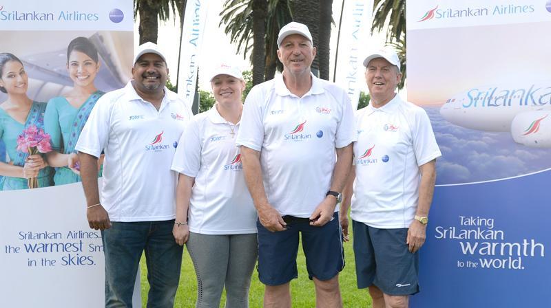 SriLankan Airlines, Manager Australia Sanjeeva Jayatileke with Sir Ian Botham and the team members.